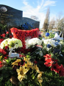 decorated with photographs of him with a horse drawn scrap metal merchants cart and a travellers wagon and terry westlake who died at the age of 54 - Christmas Grave Decorations